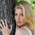 Jodi Arias' Lifetime counterpart hugs a tree.