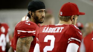 Has anyone considered that Kaepernick just had his earbuds in?